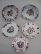 Five Hungarian painted floral porcelain plates measure 24.5cms dia largest label verso