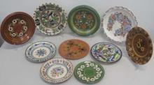 Ten Hungarian painted floral ceramic plates most signed measure 24cms dia