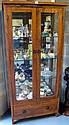 Modern hardwood display cabinet with glass shelves