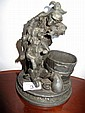 Antique French metal figure of a monkey dentist