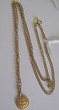 18kt gold necklace and medal weighs 10.8grams