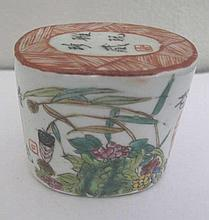 Antique Chinese Famille Rose oval porcelain seal painted with insects and flowers with painters red seals and calligraphy measures 5.7cms