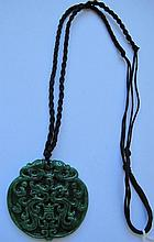 Chinese carved jade pendant with qilongs and Shou symbol measures 5cms dia