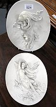Pair of antique figural wall plaques