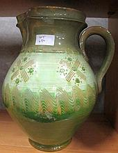 Large studio pottery green glazed incised jug 31cm