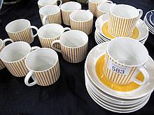Fourteen Kadett yellow striped cups and saucers