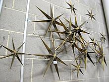 Modern gilt metal Stars wall sculpture