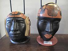 Two retro painted terracotta masks on stands 20cms
