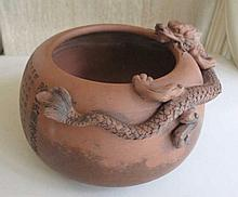 Large Chinese Zisha brush washer with a dragon on the rim and carved with a