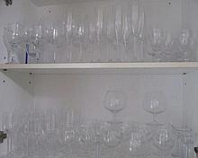 Two shelves of various Champagne, wine & brandy balloons quantity