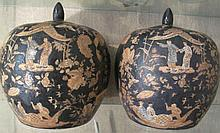 Pair Chinese Famille Noir porcelain temple jars painted with figures and ca