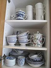 Three shelves of blue & white porcelain and matching  plates with two cupbo