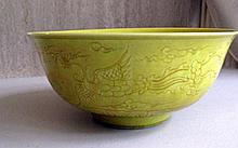 Imperial yellow monochrome porcelain bowl incised with Phoenix and clouds a