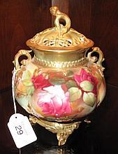 Royal Worcester gilded rose footed lidded vase
