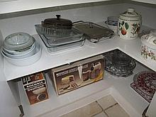 Two shelves of casserole dishes, bowls, trays etc