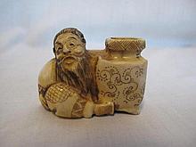 Japanese Netsuke of a ginger vendor signed