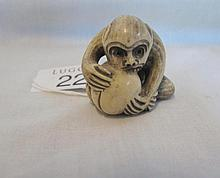Japanese Netsuke of a monkey with peach signed at