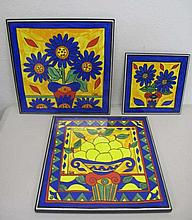 Two Large designer porcelain wall plaques with sma