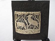 Antique carved ivory plaque on carved frame finely