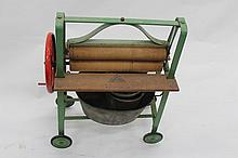 AN OLD TRI-ANG GREEN PAINTED TOY MANGLE complete