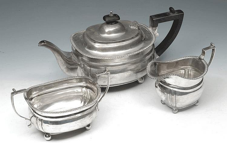 A THREE PIECE SILVER TEASET with gadrooned edge,