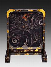 A JAPANESE MEIJI PERIOD LACQUERED TABLE SCREEN with gilt metal mounts decorated the sun rising over a stormy sea with seashell ornament, 49cm high x 39cm wide   100