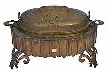 A 19TH CENTURY OTTOMAN BRAZIER, the stand supported by four scroll feet and with pierced cover, 68cm wide. Provenance, formerly the property of Walter Harris late Times Correspondent for North Africa.   100