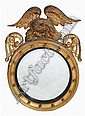 A REGENCY GILTWOOD CIRCULAR WALL MIRROR with eagle