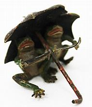 A COLD CAST BRONZE, two frogs under an umbrella,