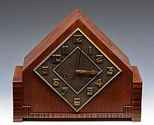AN ART DECO MANTEL CLOCK with lozenge shaped cast