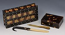 A TORTOISE SHELL RECTANGULAR TRINKET BOX of plain