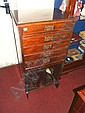 An Art Nouveau stained beech five drawer music