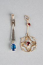AN EDWARDIAN GARNET AND PEARL SET WIREWORK PENDAN