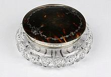 A SILVER LIDDED CUT GLASS JAR with inset tortoise