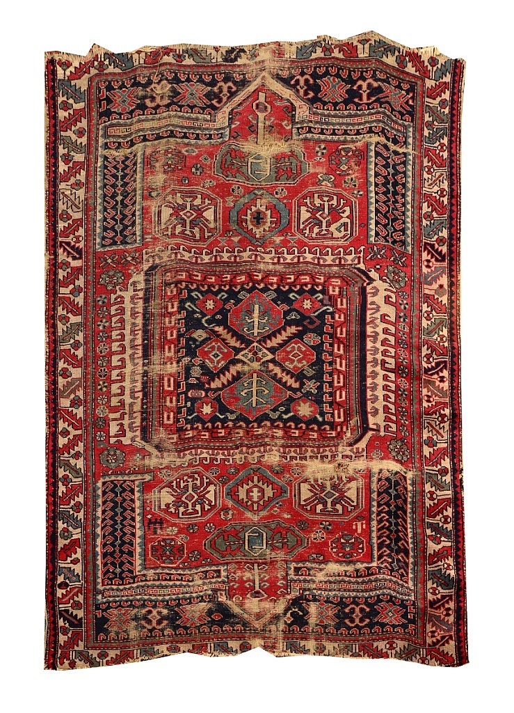 AN OLD PERGAM RUG decorated with stylistic