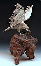 Japanese silver metal model eagle with wings spread, on a b