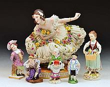 Meissen miniature lady with a muff, and five other continen
