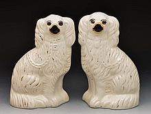 Pair of Staffordshire Pottery model spaniels 27cm high