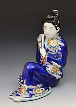 Japanese Satsuma model of a girl  holding a fan, 17cm