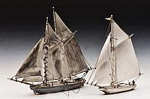 Two sterling silver small model yachts largest 16cm