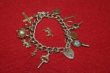 Silver gilt bracelet  with padlock clasp containing a numbe