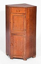Heals oak corner cupboard  circa 1910, with two cupboard se