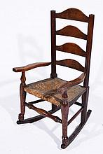 Early 20th Century oak child's rocking chair with rush seat