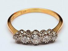 18ct gold ring with graduated five stone diamond setting