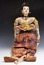 AN INDIAN OR CAMBODIAN PAINTED WOOD DOLL