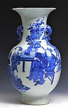 A CHINESE BLUE AND WHITE PORCELAIN BALUSTER VASE, ladies at a table, with elephant handles, Kangxi m