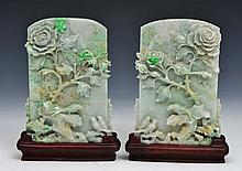 A PAIR OF CHINESE JADEITE CARVED SCREENS, birds resting beneath a flowering peony, on hardwood stand