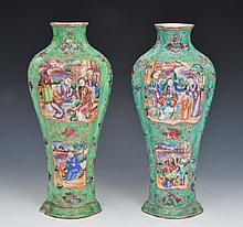 A PAIR OF CHINESE GREEN GROUND VASES, each with panels of figures, 18th Century, 28cm high