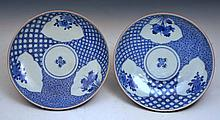 A PAIR OF JAPANESE BLUE AND WHITE PORCELAIN SHALLOW DISHES, each with three panels decorated in the