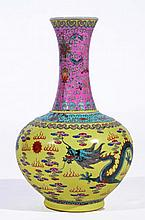 A CHINESE PORCELAIN BOTTLE VASE with waisted trumpet mouth neck decorated in the famille rose palett